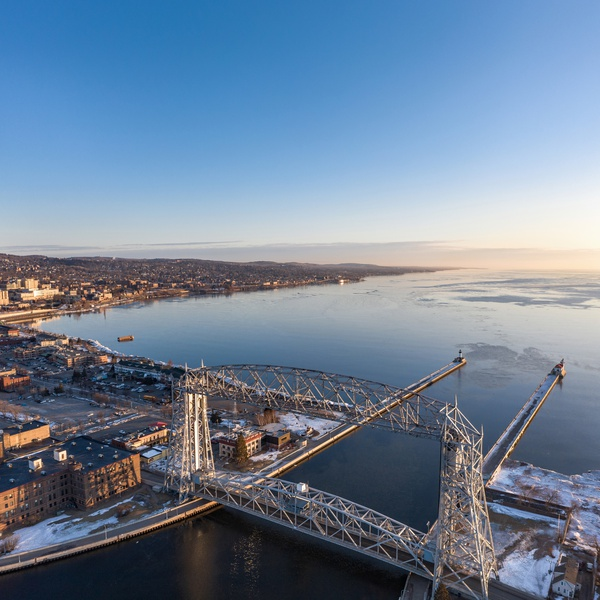 Duluth Lift Bridge Sunrise in Winter - Visit Duluth Aerial